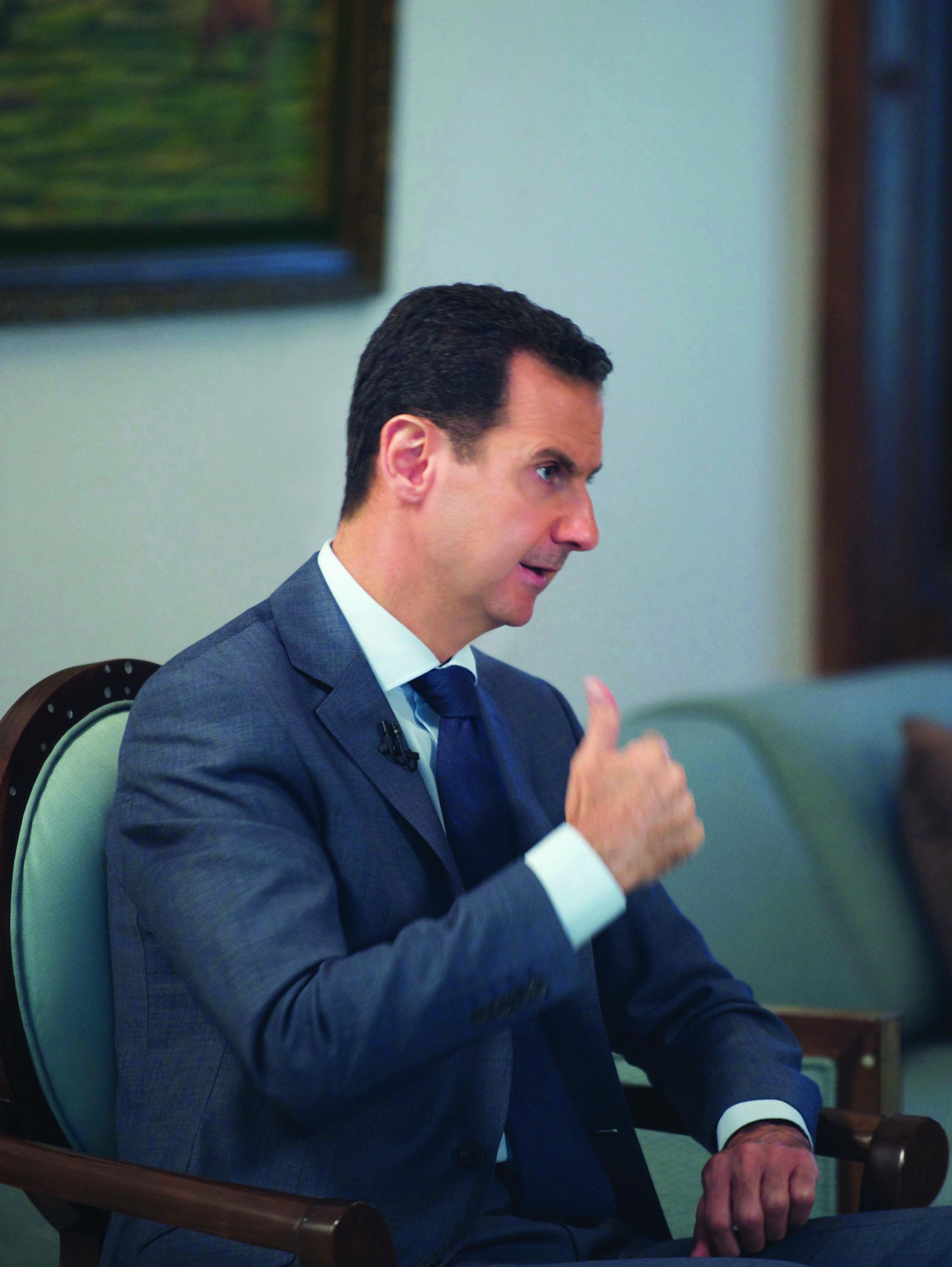 """صورة الرئيس الأسد لـ """"الوطن"""": دعمنا حماس لانها مقاومة"""