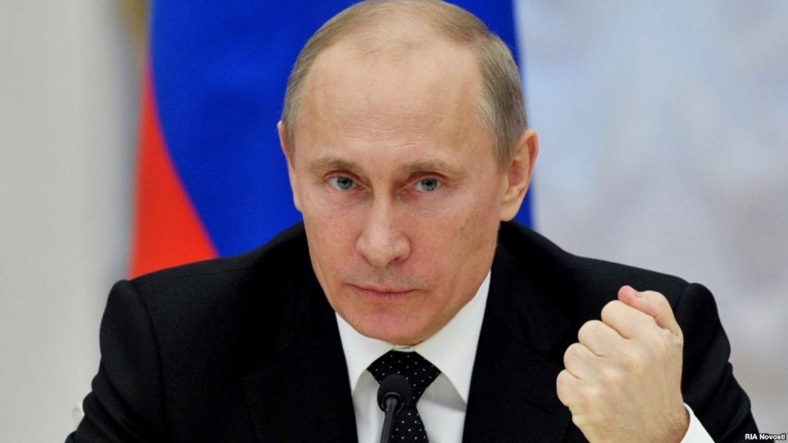 صورة بوتين: اغتيال السفير الروسي عمل استفزازي والحرب على الإرهاب ستتصاعد