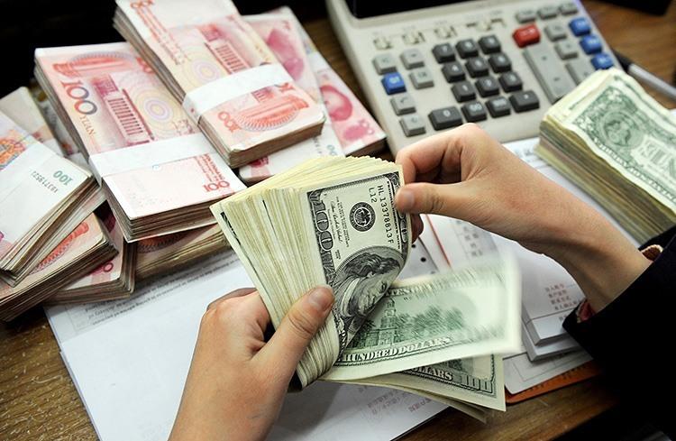 Photo of الصين تتخلى عن الدولار في معاملاتها مع دول من الشرق الأوسط