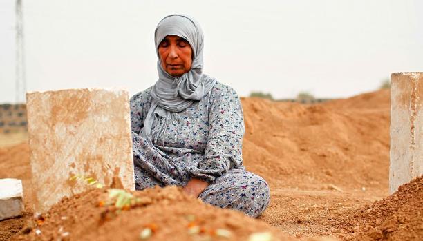 صورة مقابر جماعية في ريف دمشق..  والاستعراف على الجثث له دور في ملف المفقودين