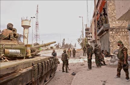 """Photo of الجيش يدمر تحصينات لإرهابيي """"داعش"""" بمحيط دير الزور"""