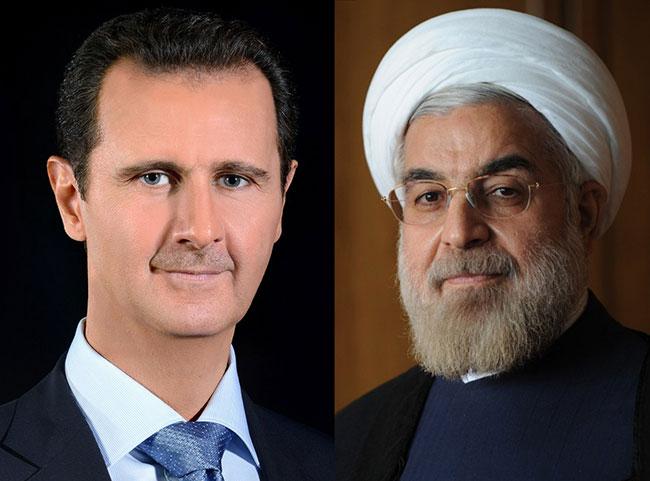 صورة الرئيس الأسد يتلقّى اتصالاً هاتفياً من الرئيس حسن روحاني