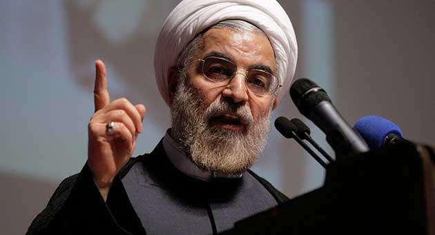 صورة روحاني: نحن رجال الحوار لكن على واشنطن رفع العقوبات أولاً