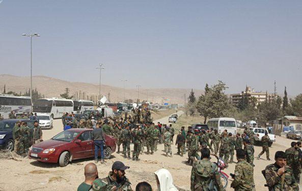 """Photo of إرهابيو """"جيش الإسلام"""" في بلدة الضمير يواصلون تسليم أسلحتهم"""