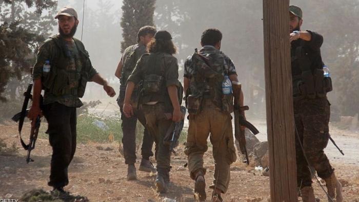 """Photo of الاشتباكات تمتد إلى كامل الريف الإدلبي.. و""""الوطنية للتحرير"""" تعلن النفير العام"""