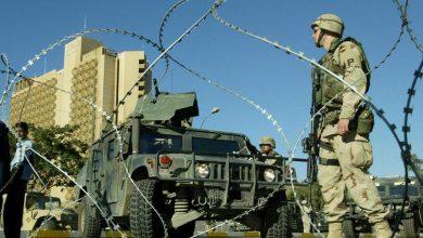 صورة تحذيرات للقوات الأمنية العراقية للابتعاد عن القواعد الأمريكية