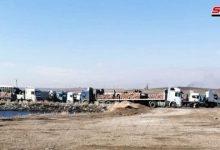 صورة الاحتلال الأمريكي يخرج 20 شاحنة محملة بحبوب مسروقة من الحسكة إلى العراق